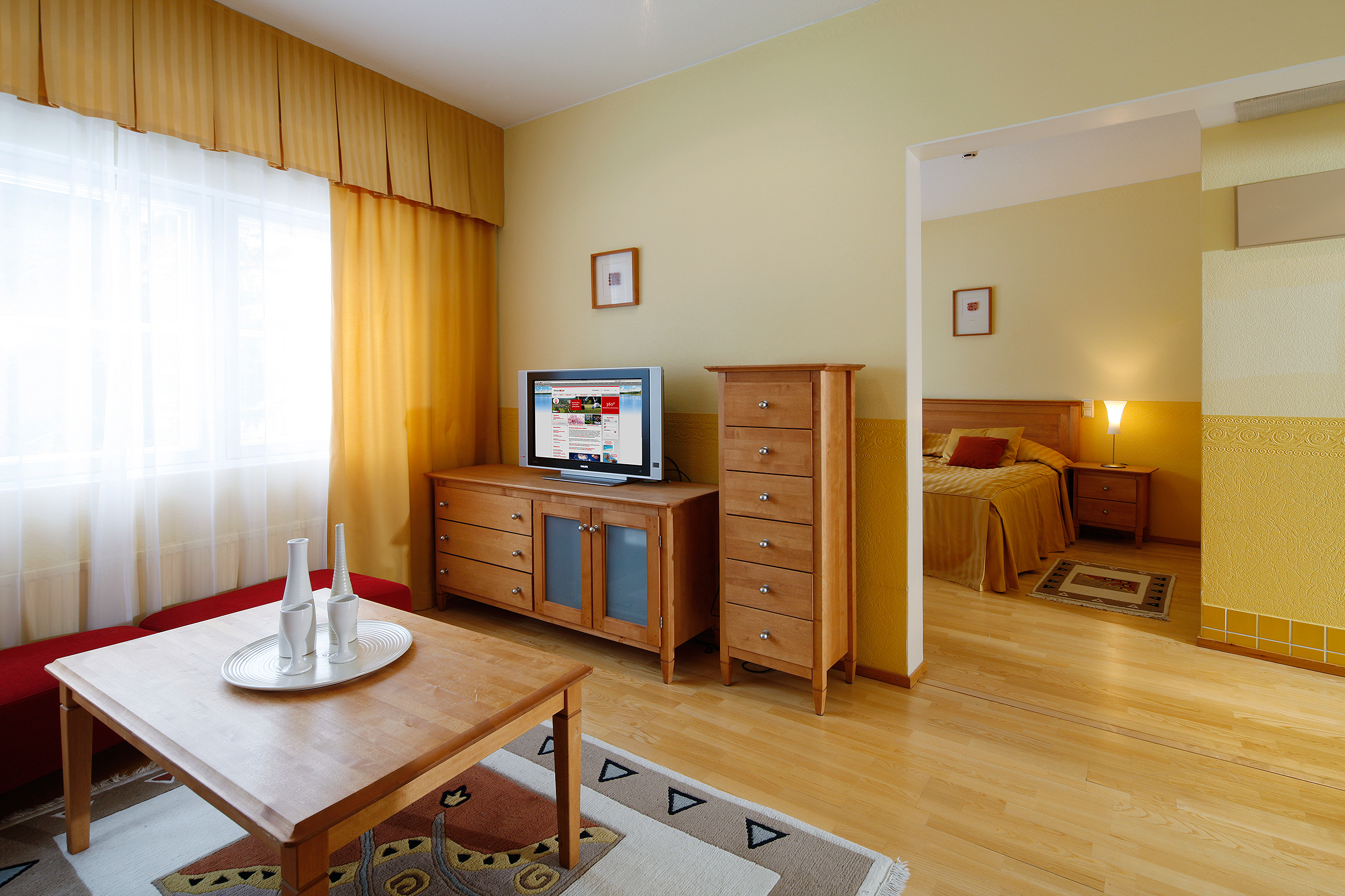 The suite at the Kuusamon Tropiikki Hotel features a separate bedroom and a  private sauna.