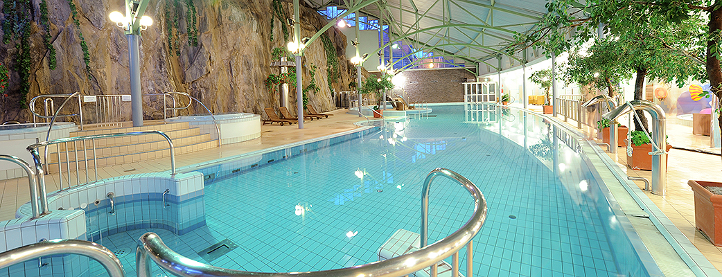 A tall rock wall brings great ambiance to the spa's pool section.
