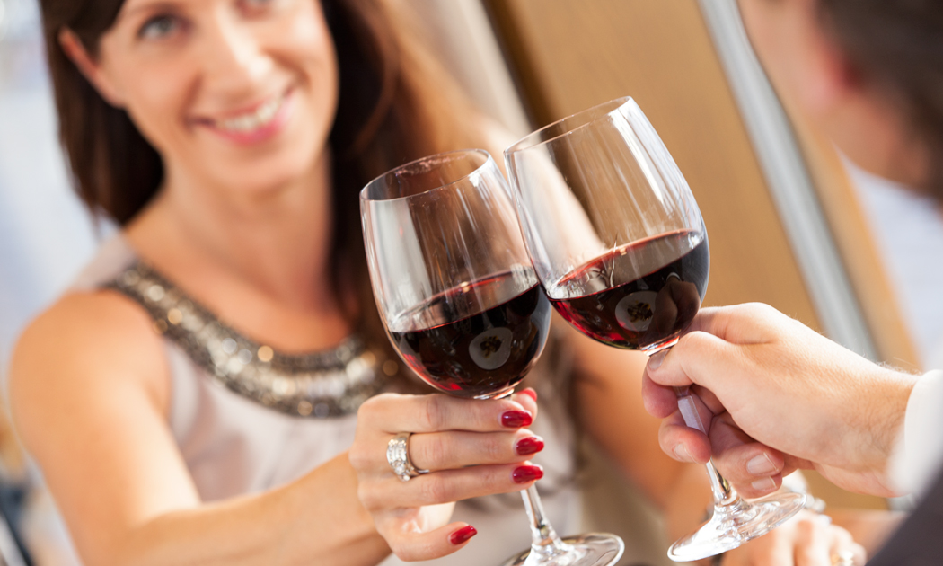 couple-doing-kippis-with-red-wine.jpg